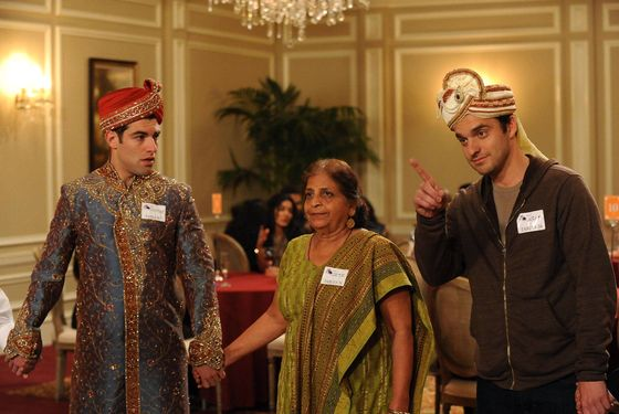 "NEW GIRL:  Schmidt (Max Greenfield, L) and Nick (Jake Johnson, R) play a game with an older Indian woman (guest star Swati Panat, C) when they attend a dating convention in the ""Table 34"" episode of NEW GIRL airing Tuesday, Feb. 5 (9:00-9:30 PM ET/PT) on FOX."