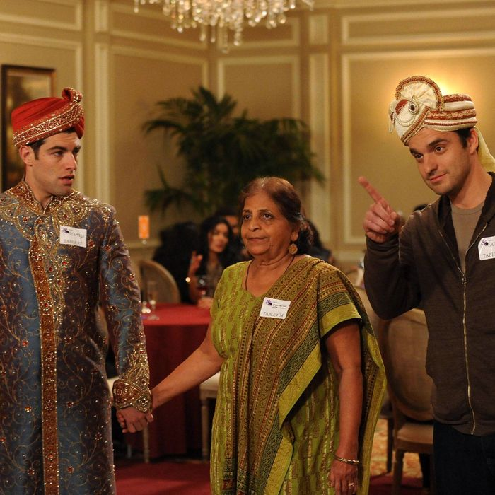 NEW GIRL: Schmidt (Max Greenfield, L) and Nick (Jake Johnson, R) play a game with an older Indian woman (guest star Swati Panat, C) when they attend a dating convention in the