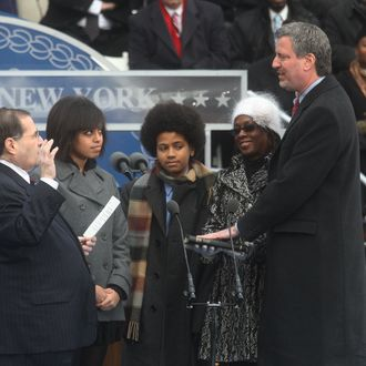NEW YORK - JANUARY 1: New York City Public Advocate Bill de Blasio takes the oath of office administered by US Congressman Jerrold Nadler (L) acoompanied by his daughter Chiara (2nd-L), son Dante (C) and wife Chirlane (2nd-R) January 1, 2010 at City Hall in New York City. Michael Bloomberg was also inaugurated as Mayor again today. (Photo by Hiroko Masuike/Getty Images) *** Local Caption *** Jerrold Nadle;Bill de Blasio