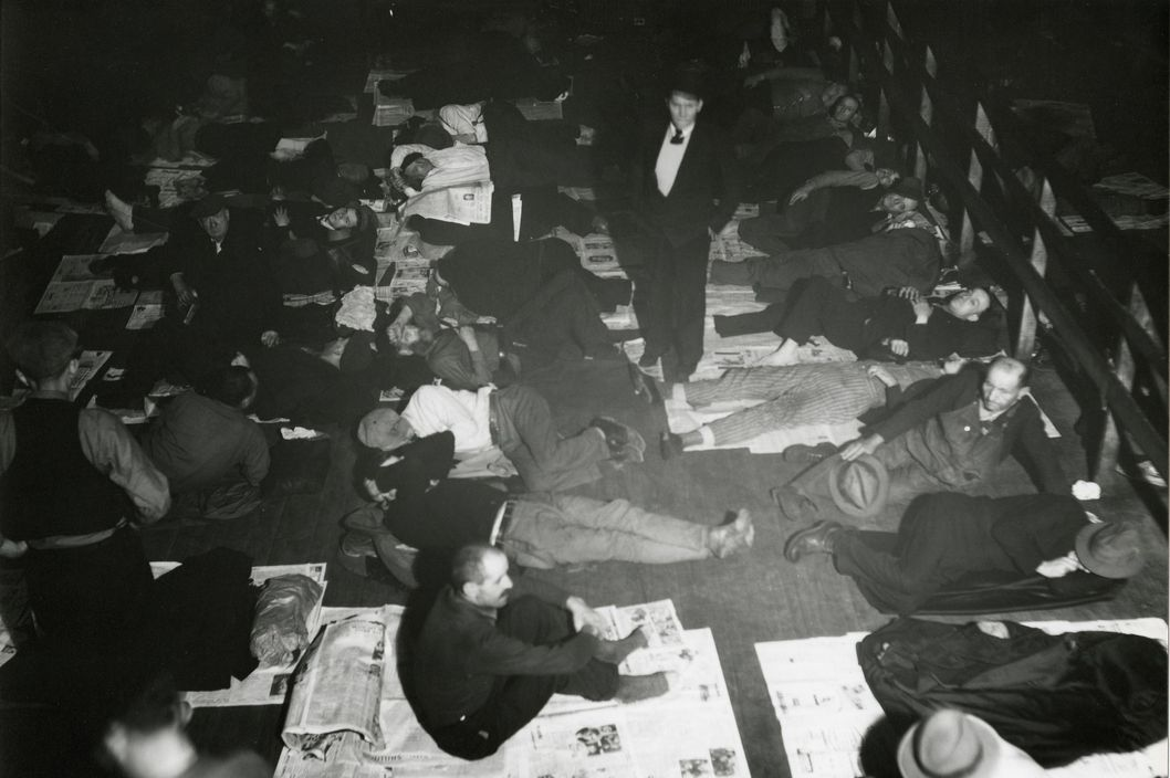 A view of men gathered in a common sleeping area during the Great Depression in Cincinnati, ca.1930s. (Photo by Paul Briol/Cincinnati Museum Center/Getty Images)