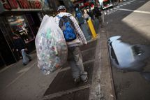 A teenager who collects bottles and cans and lives in a city shelter walks near Times Square on April 14, 2011 in New York City.