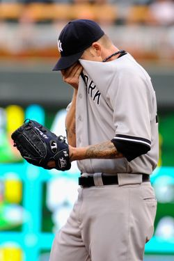MINNEAPOLIS, MN - AUGUST 20: A.J. Burnett #34 of the New York Yankees wipes the sweat off his face in the second inning against the Minnesota Twins on August 20, 2011 at Target Field in Minneapolis, Minnesota. (Photo by Hannah Foslien/Getty Images)