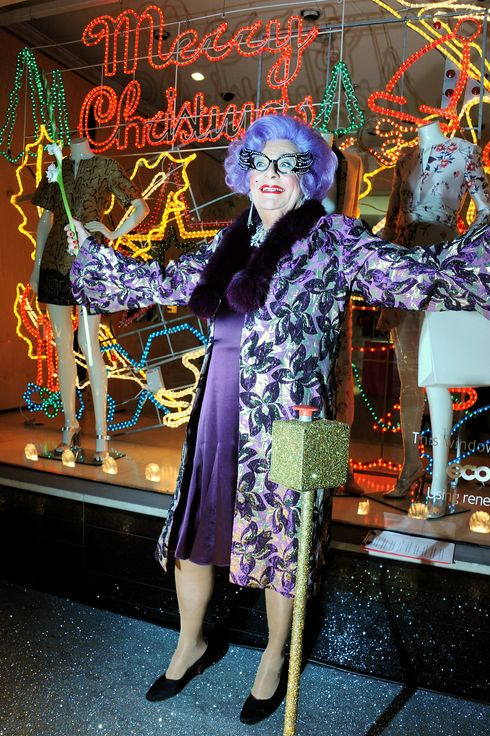 Dame Edna Everage switches on the Stella McCartney Christmas Lights at the Stella McCartney Bruton Street Store on December 4, 2013 in London, England.