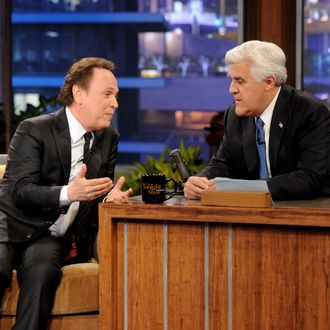 BURBANK, CA - FEBRUARY 06: Actor Billy Crystal (L) and comedian Jay Leno appear onstage during a commercial break on the final episode of