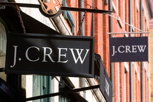 J. Crew Group Inc. signage is displayed outside of a retail store in New York, U.S., on Tuesday, March 1, 2011. J. Crew Group shareholders voted in favor of TPG Capital and Leonard Green & Partners LP's takeover, capping Chief Executive Officer Millard Drexler's months-long effort to take the apparel chain private.