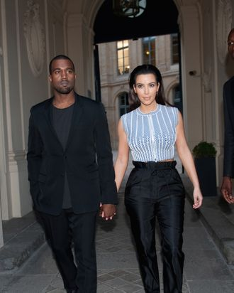 Singer Kanye West and Kim Kardashian are seen leaving the Louis Vuitton aftershow new boutique opening on July 3, 2012 in Paris, France.