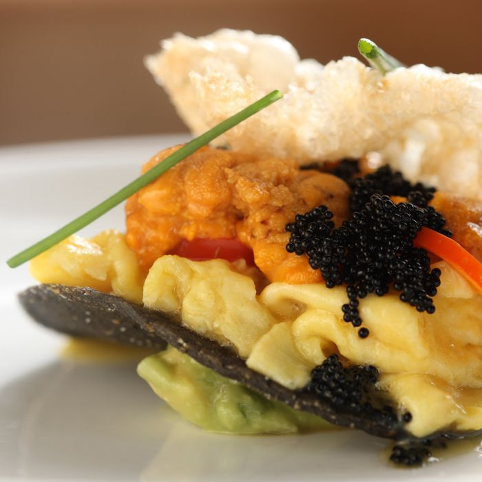Soft scrambled eggs with sea urchin, jalapeño pickles, and chicharrón.