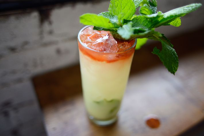 The Synthetic Happiness combines gin, coconut, saffron, lime, and mint.