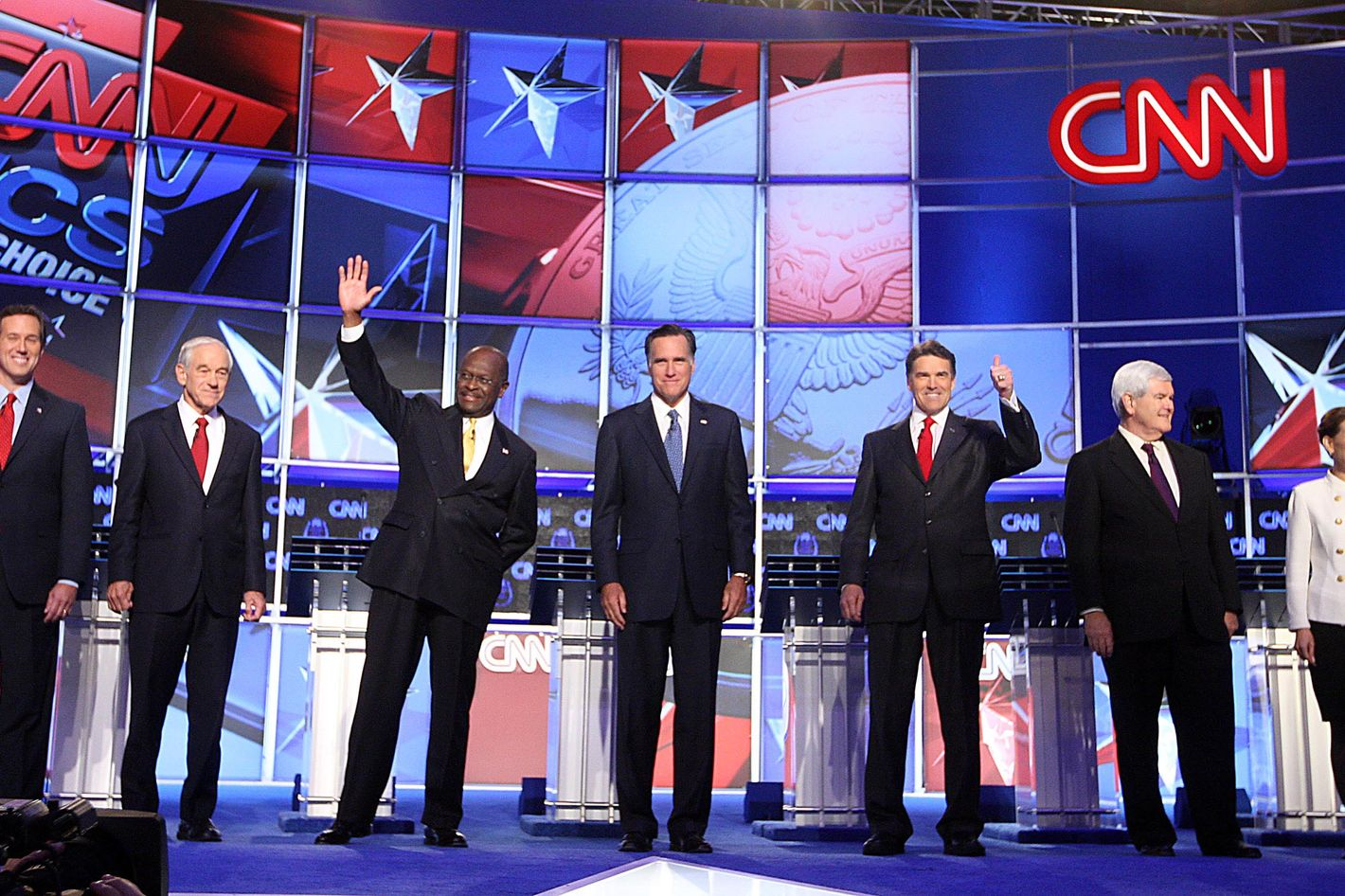 (L-R) U.S. Sen. Rick Santorum (R-PA), U.S. Rep. Ron Paul (R-TX), former CEO of Godfather's Pizza Herman Cain, former Massachusetts Gov. Mitt Romney, Texas Gov. Rick Perry, Former Speaker of the House Newt Gingrich and U.S. Rep. Michele Bachmann (R-MN)  say the Pledge of Alligence during the Republican Presidential debate hosted by CNN and The Western Republican Leadership Conference on October 18, 2011 at the The Venetian Resort Hotel Casino in Las Vegas, Nevada.  AFP PHOTO / John GURZINSKI (Photo credit should read JOHN GURZINSKI/AFP/Getty Images)