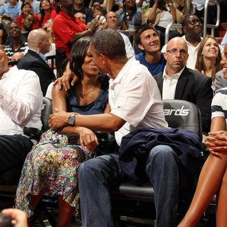 President of the United States of America Barack Obama and First Lady Michelle Obama are put on the Kiss Cam at the 2012 US Men's Senior National Team vs the Brazilian Men's Senior National Team game at the Verizon Center on July 16, 2012 in Washington, DC.