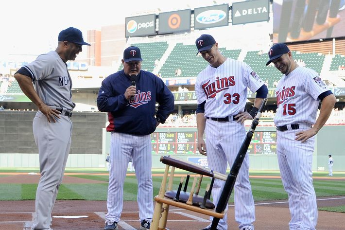 Mariano Rivera #42 of the New York Yankees is presented with a rocking chair made out of broken bats by manager Ron Gardenhire #35, Justin Morneau #33 and Glen Perkins #15 of the Minnesota Twins before the game on July 2, 2013 at Target Field in Minneapolis, Minnesota.