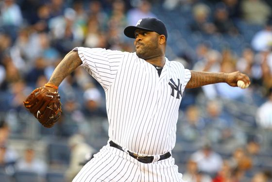 CC Sabathia #52 of the New York Yankees pitches against the Atlanta Braves on June18, 2012 at Yankee Stadium in the Bronx borough of New York City.