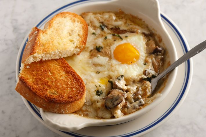 Baked eggs in a wild-mushroom cream sauce with thyme and Gruyère cheese.