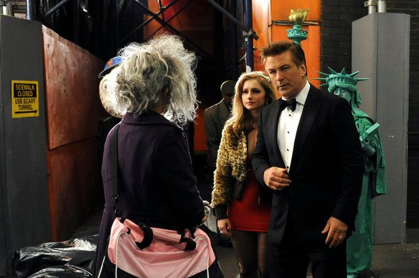 "30 ROCK -- ""The Tuxedo Begins"" Episode 608 -- Pictured: (l-r) Tina Fey as Liz Lemon, Sarah Schenkkan as Young Girl, Alec Baldwin as Jack Donaghy."