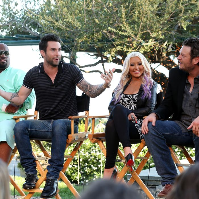 The Voice's Cee Lo Green, Adam Levine, Christina Aguilera, and Blake Shelton speak onstage during the NBCUniversal's