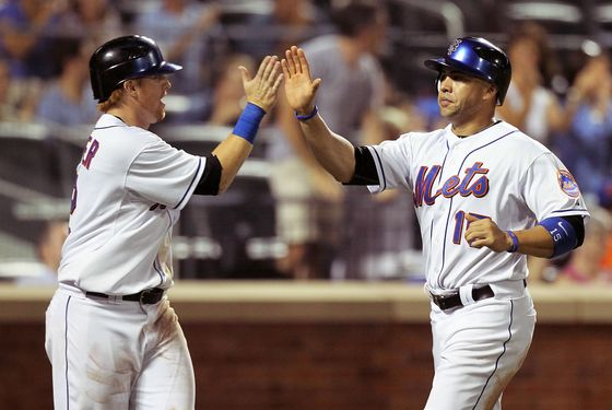 Carlos Beltran #15 and Justin Turner #2 of the New York Mets celebrate after scoring in the sixth inning against the St. Louis Cardinals on July 19, 2011.