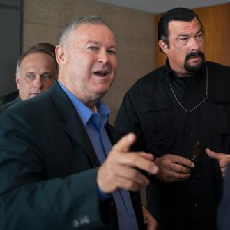 "Rep. Dana Rohrabacher, foreground, who is leading a U.S. Congressional delegation to the Russian Federation, U.S. actor Steven Seagal, right, and Rep. Steve King, left, speak to the media after a news conference in U.S. Embassy in Moscow, Russia, Sunday, June 2, 2013. A U.S. Congressional delegation to Russia learned little about what could have been done to prevent the Boston Marathon bombings, but got to hang out with Steven Seagal. Rep. Dana Rohrabacher, a California Republican who led the six-person delegation this week, said at a press conference Sunday that there was ""nothing specific"" that could have helped April's bombings, but that the U.S. and Russia needed to work more closely on joint security threats.(AP Photo/Alexander Zemlianichenko)"