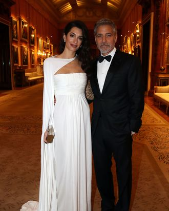 Amal and George Clooney at Buckingham Palace.