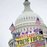 "WASHINGTON - SEPTEMBER 12:  A sign that reads ""Congress, You're Fired!"" is seen during a rally on the West Front of the U.S. Capitol Building on September 12, 2010 in Washington, DC.  Members of the Tea Party and other activists gathered at the ""Remember In November"" Rally to protest large government and rally for conservative principals nearly two months before US midterm elections.  (Photo by Brendan Smialowski/Getty Images)"