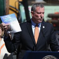NEW YORK, NY - MAY 05: New York City Mayor Bill de Blasio speaks in front of a residential construction site while unveiling his affordable housing plan on May 5, 2014 in the Brooklyn borough of New York City. The mayor's $41 billion 'Housing New York - A Five-Borough Ten-Year Plan', billed by his office as the most ambitious affordable housing plan in U.S. history, plans to build or preserve 200,000 apartments in the next decade. The project would serve more than half a million low and middle income New Yorkers. New York City has some of the highest rents and property values in the nation. (Photo by John Moore/Getty Images)
