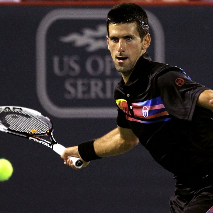 MONTREAL, QC - AUGUST 13: Novak Djokovic of Serbia returns a shot to Jo-Wilfried Tsonga of France during the Rogers Cup at Uniprix Stadium on August 13, 2011 in Montreal, Canada. (Photo by Matthew Stockman/Getty Images)