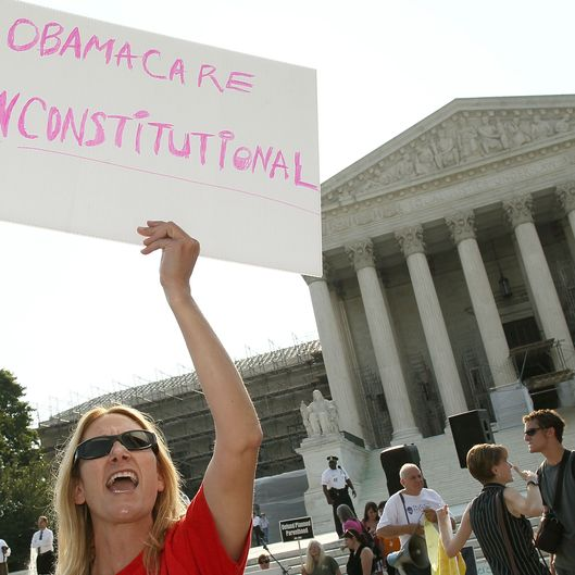 WASHINGTON, DC - JUNE 28: A women protests against the Obama administrations health care plan during a protest in front of the U.S. Supreme Court, on June 28, 2012 in Washington, DC. Today the high court is expected to rule on the constitutionality of the sweeping health care law championed by President Barack Obama.  (Photo by Mark Wilson/Getty Images)
