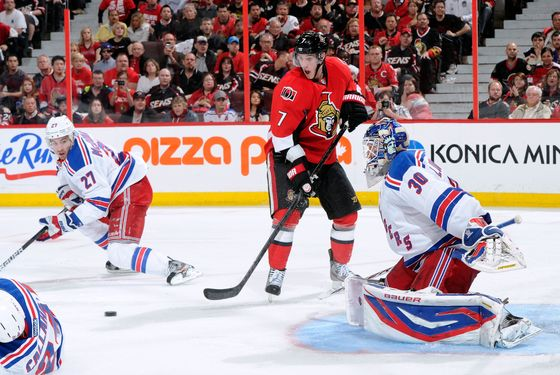 OTTAWA, CANADA - APRIL 16:  Kyle Turris #7 of the Ottawa Senators watches the rebounding puck in front of Henrik Lundqvist #30 of the New York Rangers in Game Three of the Eastern Conference Quarterfinals during the 2012 NHL Stanley Cup Playoffs at the Scotiabank Place on April 16, 2012 in Ottawa, Ontario, Canada.  The Rangers defeated the Senators 1-0.  (Photo by Richard Wolowicz/Getty Images)