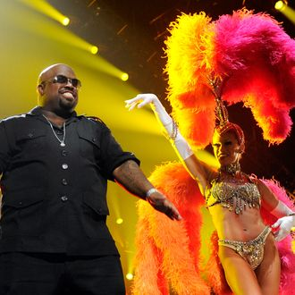 LAS VEGAS, NV - FEBRUARY 18: (EXCLUSIVE COVERAGE) Recording artist Cee Lo Green (L) performs with a showgirl from the Jubilee! production show at the Keep Memory Alive foundation's