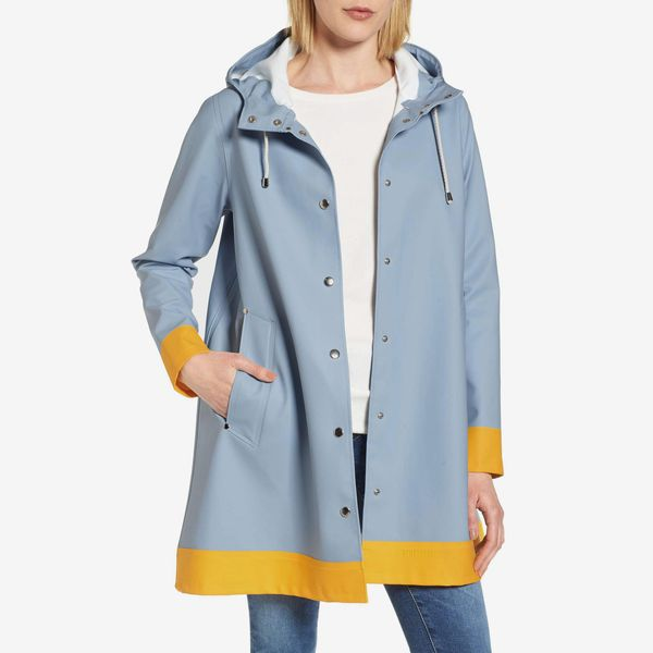Stutterheim Mosebacke Frame Colorblock Raincoat- strategist best light blue rain coat with yellow trim and draw string hood