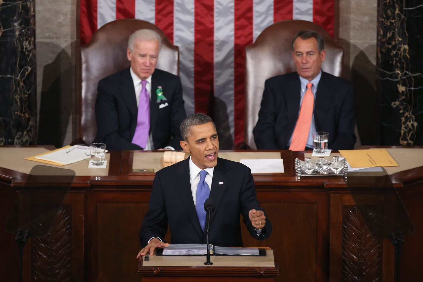 "WASHINGTON, DC - FEBRUARY 12:  Flanked by U.S. Vice President Joe Biden (L) and Speaker of the House John Boehner (R), U.S. President Barack Obama (C) delivers his State of the Union speech before a joint session of Congress at the U.S. Capitol February 12, 2013 in Washington, DC. Facing a divided Congress, Obama concentrated his speech on new initiatives designed to stimulate the U.S. economy and said, ""It's not a bigger government we need, but a smarter government that sets priorities and invests in broad-based growth"".  (Photo by Mark Wilson/Getty Images)"