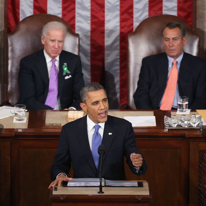 WASHINGTON, DC - FEBRUARY 12: Flanked by U.S. Vice President Joe Biden (L) and Speaker of the House John Boehner (R), U.S. President Barack Obama (C) delivers his State of the Union speech before a joint session of Congress at the U.S. Capitol February 12, 2013 in Washington, DC. Facing a divided Congress, Obama concentrated his speech on new initiatives designed to stimulate the U.S. economy and said,