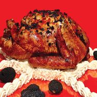 Slow-roasted turkey in black-truffle butter.