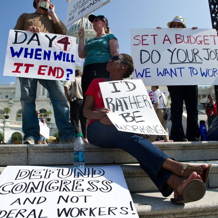 Federal workers demonstrate against the government shutdown in front of the US Capitol in Washington on October 4, 2013. The US government shut down for the first time in 17 years on October 1 after lawmakers failed to reach a budget deal by the end of the fiscal year.