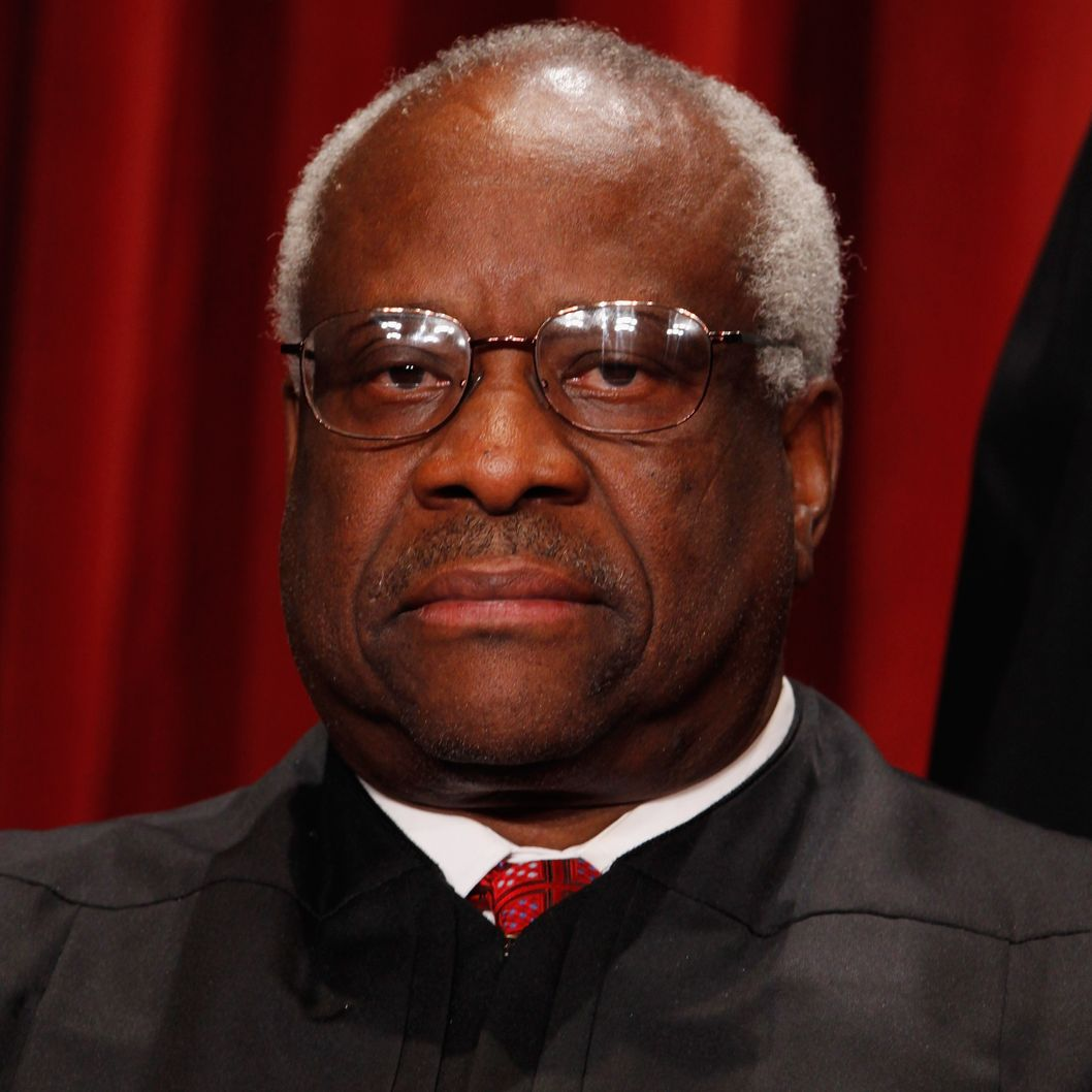 U.S. Supreme Court Associate Justice Clarence Thomas poses for photographs in the East Conference Room at the Supreme Court building October 8, 2010 in Washington, DC. This is the first time in history that three women are simultaneously serving on the court.