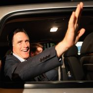 THE VILLAGES, FL - JANUARY 30: Republican presidential candidate, former Massachusetts Gov. Mitt Romney waves as he rides away in his vehicle after a grassroots rally with supporters at Lake Sumter Landing on January 30, 2012 in The Villages, Florida. Romney is campaigning across the state ahead of the January 31 Florida primary. (Photo by Joe Raedle/Getty Images)