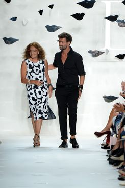 Designers Diane Von Furstenberg and Yvan Mispelaere walk the runway at the Diane Von Furstenberg Spring 2013 fashion show during Mercedes-Benz Fashion Week at The Theatre at Lincoln Center on September 9, 2012 in New York City.