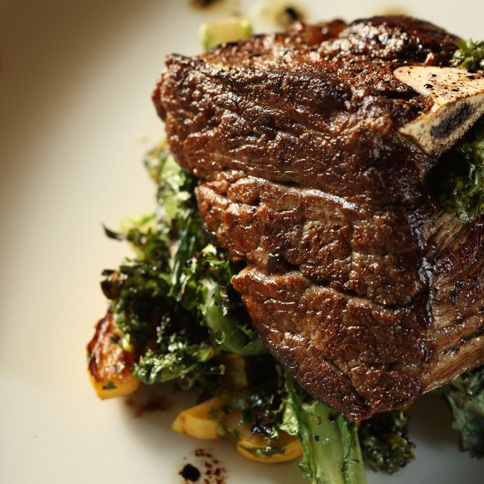 Forty-day-dry-aged bone-in filet with delicata-squash salsa verde and grilled winter greens.
