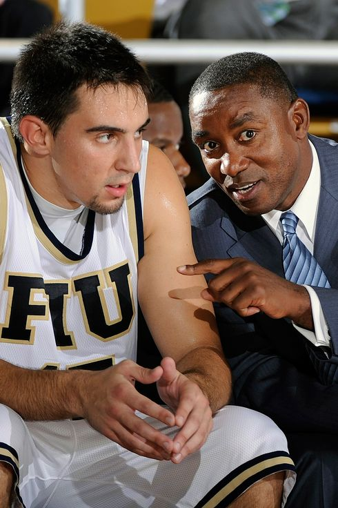 Florida International University Head Coach Isiah Thomas gives instructions to forward Nikola Gacesa (15) during the game against Northwood University in Northwood's 71-61 victory in an exhibition game at U.S. Century Bank Arena, Miami, Florida.