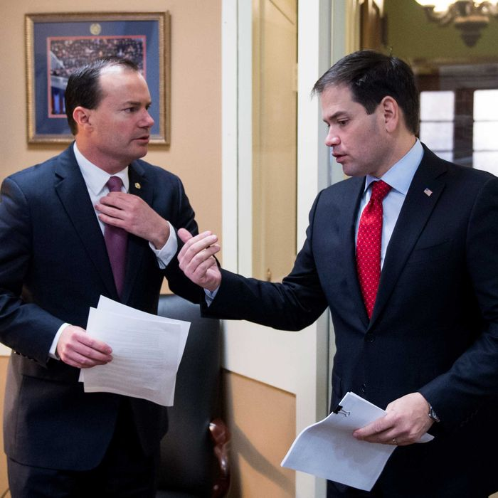 Sen. Mike Lee, R-Utah, left, and Sen. Marco Rubio, R-Fla., prepare to hold a news conference on a tax plan rollout on Wednesday, March 4, 2015.
