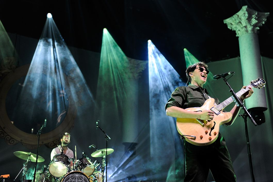 LONDON, ENGLAND - NOVEMBER 13:  Chris Tomson (L) and Ezra Koenig of Vampire Weekend performs at 02 Arena on November 13, 2013 in London, England.  (Photo by Matt Kent/WireImage)