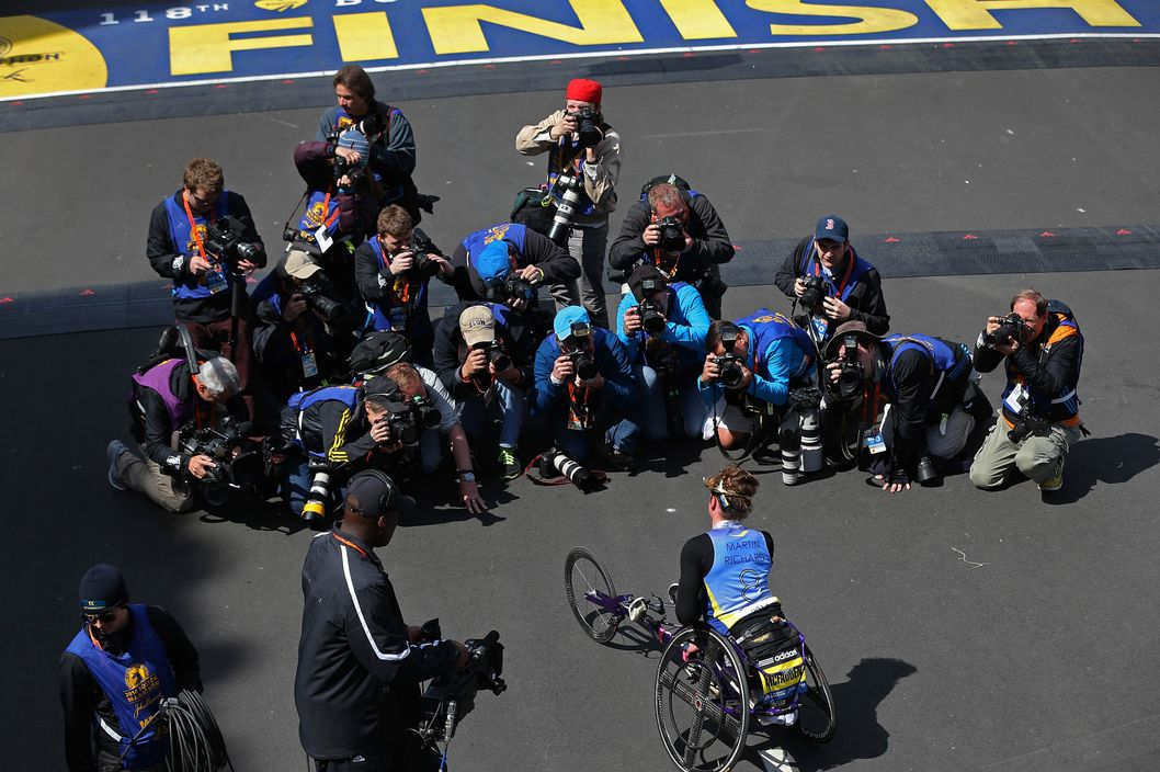 BOSTON - APRIL 21: Tatyana McFadden, of the United States, poses for photographers at the finish line after winning the women's wheelchair division of the 118th Boston Marathon on Monday, April 21, 2014. (Photo by David L. Ryan/The Boston Globe via Getty Images)