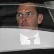LONDON, ENGLAND - NOVEMBER 29:  James Murdoch leaves the annual general meeting of BSkyB after resisting calls for him to stand down as chairman on November 29, 2011 in London, England. A portion of shareholders are reportedly set to vote against Mr Murdoch's re-appointment to Chairman as they believe his connections to News International's phone hacking scandal could damage BSkyB's reputation.  (Photo by Oli Scarff/Getty Images)