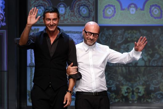 Designers Stefano Gabbana (L) and Domenico Dolce acknowledge the audience at the end of the last D&G fashion show as part of Milan Fashion Week Womenswear Spring/Summer 2012 on September 22, 2011 in Milan, Italy.