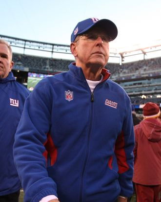 Tom Coughlin, Head coach of the New York Giants leaves the field after a 23-10 loss to the Washington Redskins during their game at MetLife Stadium on December 18, 2011 in East Rutherford, New Jersey.