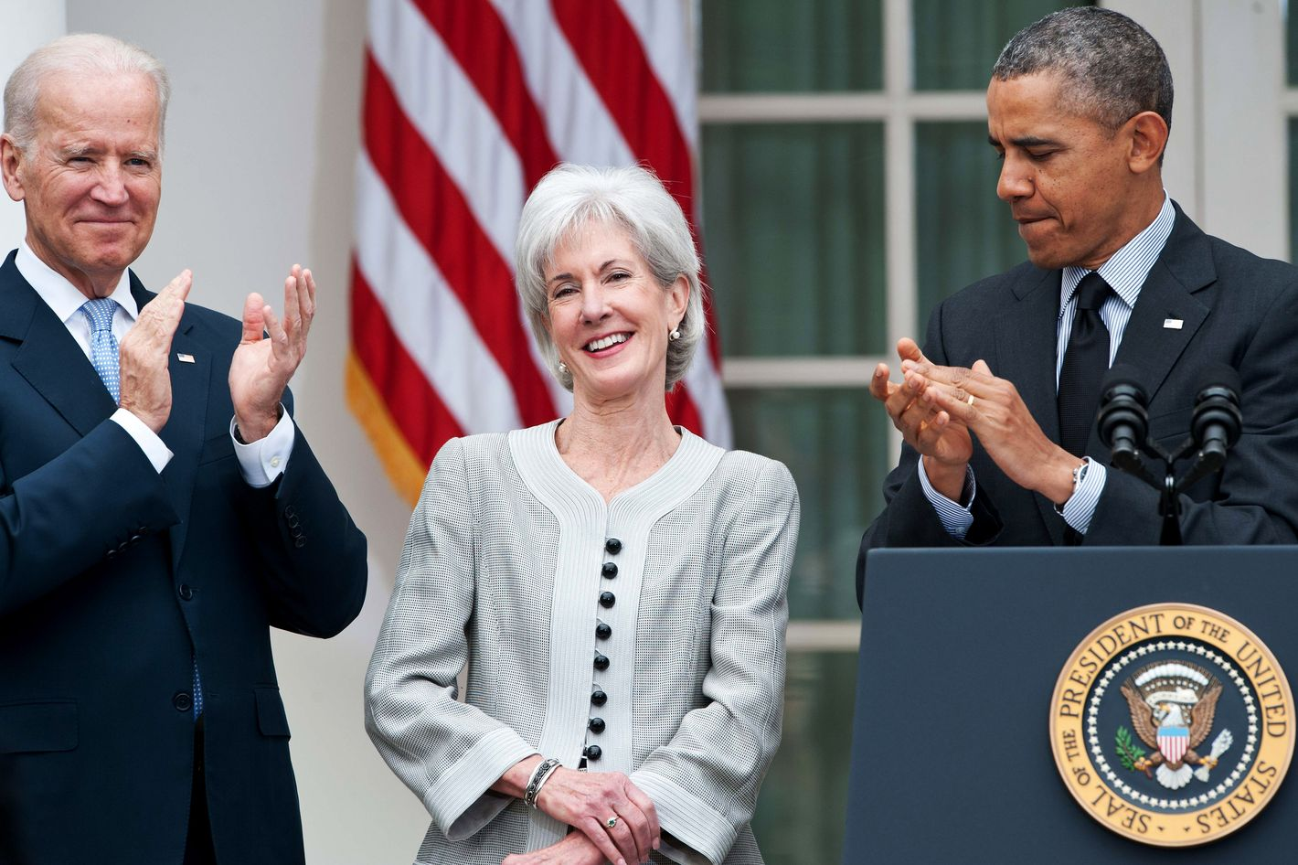 US President Barack Obama (R) and Vice President Joe Biden (L) applaud outgoing Heath and Human Services Secretary Kathleen Sebelius as Obama names Sylvia Mathews Burwell, his current budget director, to replace her in the Rose Garden at the White House in Washington,DC on April 11, 2014. Sebelius resigned, paying the price for the chaotic initial rollout of the US president's signature health care law.    AFP PHOTO/Nicholas KAMM        (Photo credit should read NICHOLAS KAMM/AFP/Getty Images)