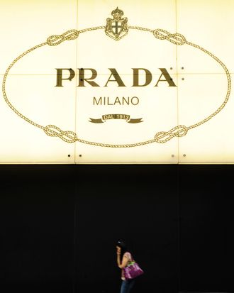 Pedestrians walk past a Prada shop in Hong Kong on June 12, 2011. Italian luxury fashion house Prada is set to raise as much as 2.6 billion USD after setting the price range for its highly anticipated offering in Hong Kong on June 24, a report said on June 6. The Milan-based company plans to sell 423.28 million shares at an indicative price range of HK$36.50-HK$48.0 (4.70-6.20 USD) each, Dow Jones Newswires reported, quoting an unnamed source familiar with the deal. AFP PHOTO / Antony DICKSON (Photo credit should read ANTONY DICKSON/AFP/Getty Images)