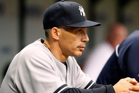 ST. PETERSBURG - APRIL 08:  Manager Joe Girardi #28 of the New York Yankees directs his team against the Tampa Bay Rays during the game at Tropicana Field on April 8, 2012 in St. Petersburg, Florida.  (Photo by J. Meric/Getty Images)