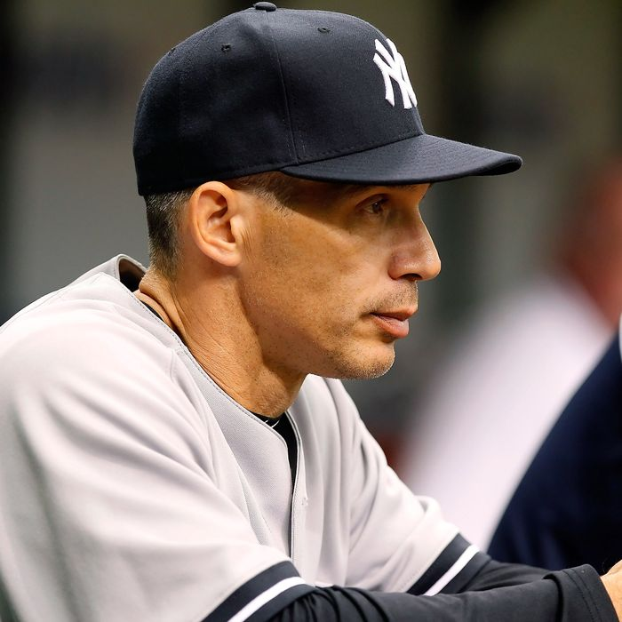 Manager Joe Girardi #28 of the New York Yankees directs his team against the Tampa Bay Rays