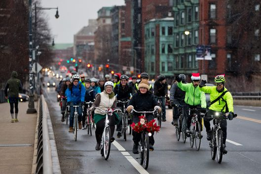 BOSTON - DECEMBER 21: Cyclists partake in the Boston Cyclists Union winter bike ride over the Mass Avenue Bridge during a snow flurry on December 21, 2014. (Photo by Matthew J. Lee/The Boston Globe via Getty Images)