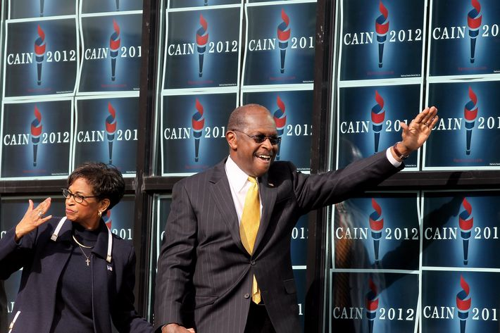 "ATLANTA, GA - DECEMBER 03:  Republican presidential candidate Herman Cain and his wife Gloria Cain arrives to speak during the scheduled opening of a local campaign headquarters on December 3, 2011 in Atlanta, Georgia. Cain took time to reassess the condition of his campaign ""because of all this media firestorm stuff,"" adding, ""my wife and family comes first.""  (Photo by Scott Olson/Getty Images)"